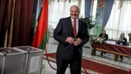 President Alyaksandr Lukashenka votes at a polling station in Minsk on November 17.
