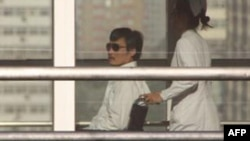 Chinese activist Chen Guangcheng is seen on a wheelchair pushed by a nurse at the Chaoyang hospital in Beijing on May 2.