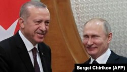 Russian President Vladimir Putin (right) meets with Turkish counterpart Recep Tayyip Erdogan in the Black Sea resort of Sochi on February 14.