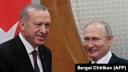 Russian President Vladimir Putin (right) meets with his Turkish counterpart, Recep Tayyip Erdogan, in the Black Sea resort of Sochi on February 14.