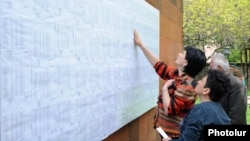 Armenia - Voters look for their names on electoral rolls posted outside a polling station in Yerevan, 6May2012.