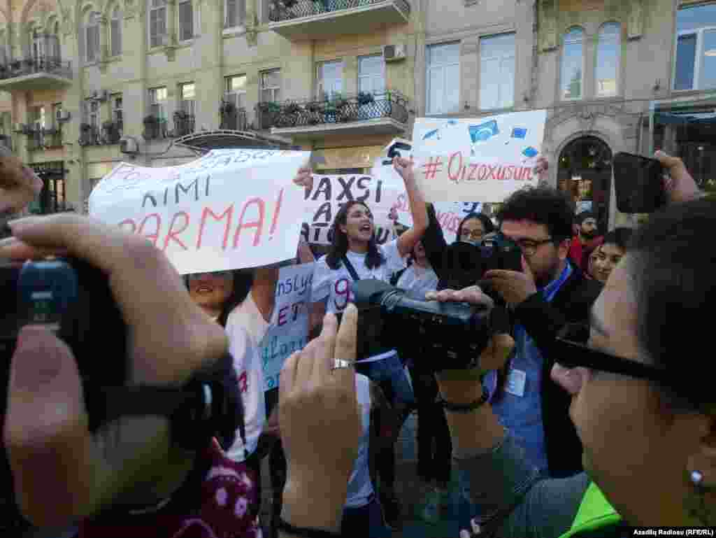 "Signs that included a hashtag meaning ""let girls study"" appeared at the October 20 rally. Moments later, many of the signs were snatched from the protesters by police. Women's rights in Azerbaijan have become a flash-point issue after a Baku man stabbed his wife to death in front of their children earlier this month."