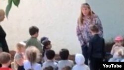 In the video, the kindergarten principal can be seen forcing a boy to kneel in front of her.