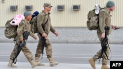 U.S. soldiers before boarding a plane on their way home from Afghanistan at the U.S. transit center at Manas in March.
