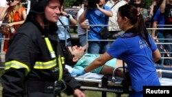 Ռուսաստան - Շտապ բուժօգնության աշխատակիցները օգնություն են ցուցաբերում Մոսկվայի մետրոպոլիտենի վթարի հետևանքով տուժածներին, 15-ը հուլիսի, 2014թ․