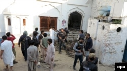File photo of a recent attack on a Shi'ite mosque in Pakistan.