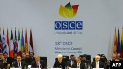 Lithuania -- President Dalia Grybauskaite (C) addresses an OSCE Ministerial Council meeting in Vilnius, 06Dec2011