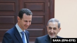 SYRIA -- Syrian President Bashar Assad (L) meets with Akbar Velayati, a top adviser to Iran's supreme leader, in Damascus, April 12, 2018