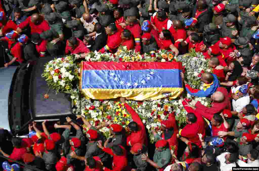 A vehicle carries a coffin with the remains of late Venezuelan President Hugo Chavez through the streets of Caracas on March 6. Chavez died on March 5 at the age of 58.