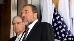 U.S. Envoy George Mitchell (left) and Israeli Foreign Minister Avigdor Lieberman