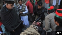 Rescuers move an injured man into a hospital following the attack on Bacha Khan university in Charsadda on January 20.