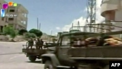 A TV grab shows Syrian troops deployed in the flashpoint town of Jisr al-Shughour on June 14. International media have been denied access to areas of unrest.