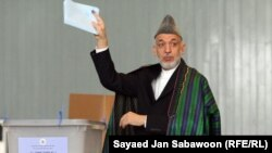 President Hamid Karzai casts his ballot at a voting station in Kabul.