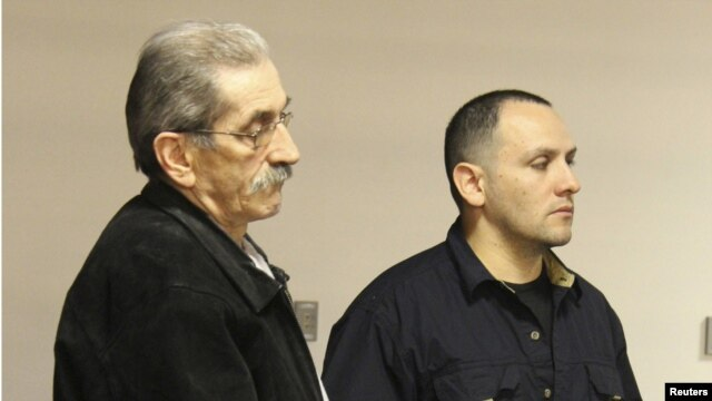 Dejan Radojkovic (left), a former Bosnian-Serb police commander wanted in his native country for alleged atrocities at Srebrenica, is seen in Las Vegas during his deportation on May 23.