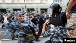 Beatings, Arrests As Russians Protest Pension Reforms