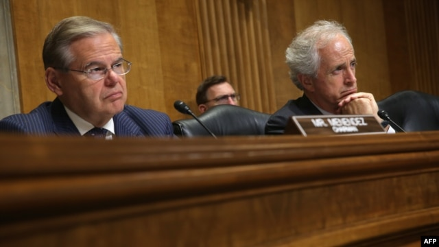 U.S. Senate Foreign Relations Committee Chairman Robert Menendez (left) and ranking member Bob Corker listen during a hearing before the committee on Capitol Hill in Washington last month.