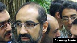 Iranian-American scholar Kian Tajbakhsh, seen here speaking to reporters in prison in September 2007, is among those currently on trial in Tehran.