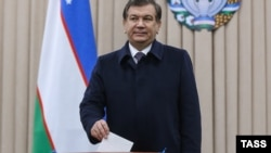 Shavkat Mirziyaev casts his ballot in Tashkent on December 4.