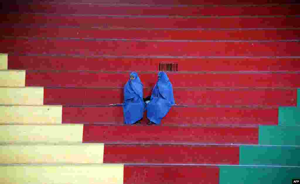 Afghan women sit in the bleachers at a women's Taekwon-Do match in Herat. (AFP/Aref Karimi)