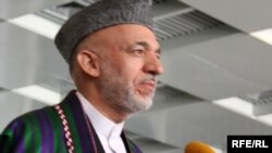 Hamid Karzai speaks to reporters after voting in Kabul on August 20.