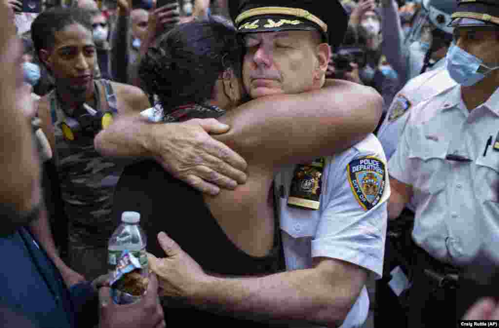 New York -- Chief of Department of the New York City Police, Terence Monahan, hugs an activist as protesters paused while walking in New York, Monday, June 1, 2020.