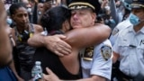 U.S. -- America Protests New York -- Chief of Department of the New York City Police, Terence Monahan, hugs an activist as protesters paused while walking in New York, Monday, June 1, 2020.