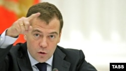 President Dmitry Medvedev speaks at the meeting with businessmen in Moscow on October 21.