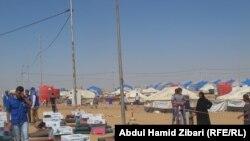 Палаточный лагерь для беженцев из захваченного боевиками Мосула. Эрбиль, 18 июня 2014 года.