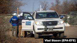 OSCE observers work at a checkpoint close to Zolote in the Luhansk region earlier this month.