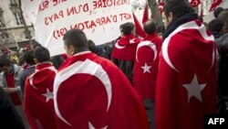 People wearing the Turkish flag take part in a rally next to the French National Assembly in Paris in mid-December.