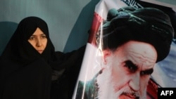 An Iranian woman marks the anniversary of the 1979 return to Tehran of Ayatollah Khomeini.