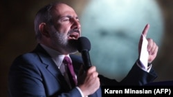 Armenian acting Prime Minister Nikol Pashinian delivers a speech during a rally in central Yerevan on June 21