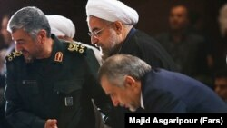 Iranian president Hassan Rouhani (C) alongside IRGC's top commander Mohammad Ali Jafari (L) and his brother Hossein Fereydoun in a ceremony in Tehran On September 16, 2013.