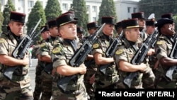 French and Tajik soldiers participate in a parade in Dushanbe in 2011.