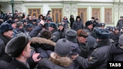 Demonstrators clash with police during a rally in Kazan on March 18 sparked by the death of Sergei Nazarov while in police custody.