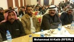 مهجرون في الموصل خلال حفل توزيع دور عليهم