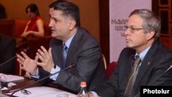 Armenia - Prime Minister Tigran Sarkisian (L) and U.S. Ambassador John Heffern attend a conference in Yerevan, 14Jun2013.