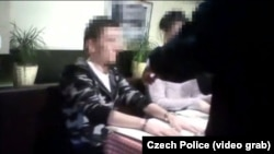 A screen grab from a video released by the Czech police showing the arrest of alleged Russian hacker Yevgeny Nikulin in Prague last month.