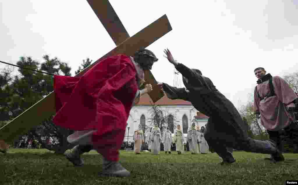 Belarusian Catholics reenact a moment in the life of Jesus Christ near a Catholic church in Minsk on April 1. (Reuters/Vasily Fedosenko)