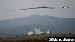 Nagorno-Karabakh - Armenian Mi-24 helicopters fire rockets during military exercises, 14Nov2014.