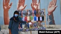 A street vendor sells face masks in Kabul.