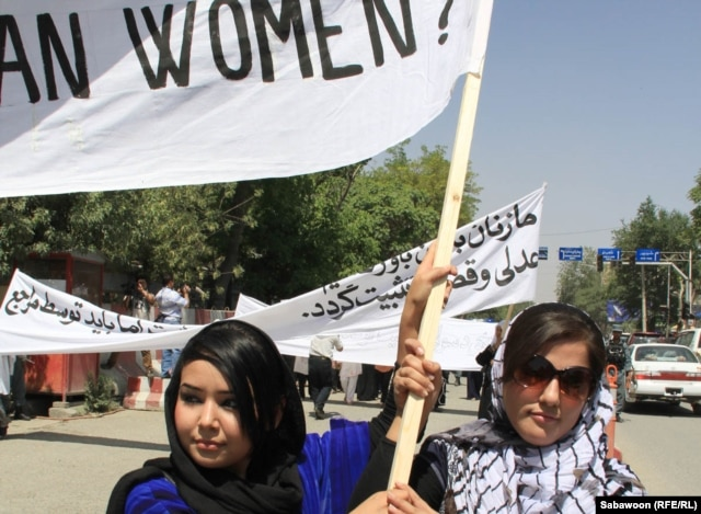 Afghan women march in Kabul on July 11 to protest the public execution of a young woman for alleged adultery.
