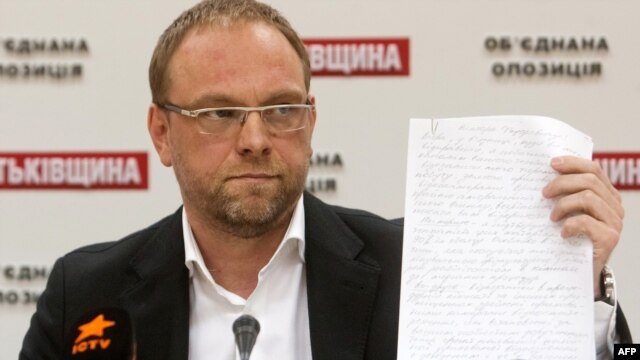 Serhiy Vlasenko, a lawyer for Yulia Tymoshenko, displays a letter she wrote to the President Viktor Yanukovych during a press conference in Kyiv in October.