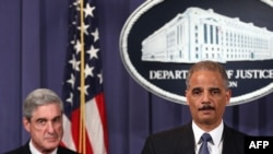 Attorney General Eric Holder (right) and FBI Director Robert Mueller at a news conference in Washington on October 11 announcing details of the alleged assassination plot targeting the Saudi ambassador.