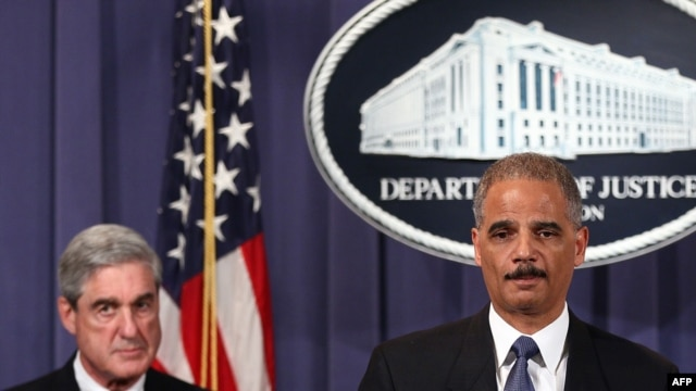 U.S. Attorney General Eric Holder (right) and FBI Director Robert Mueller divulge details of an alleged Iranian plot to kill the Saudi ambassador to the United States and bomb the embassies of Saudi Arabia and Israel in Washington.