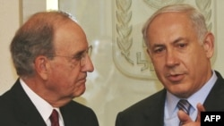 Israeli Prime Minister Binyamin Netanyahu (right) meets with U.S. envoy George Mitchell in Jerusalem.