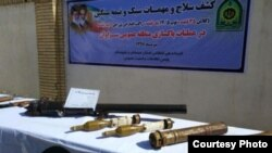 Photo released by Iran's media allegedly of weapons confiscated from Jaish ul-Adl hideout