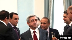 Armenia -- President Serzh Sarkisian and his coalition partners celebrate the signing of a declaration endorsing his reelection bid, 17Feb2011.