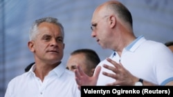 Moldova's Democratic Party (PDM) says the government of Prime Minister Pavel Filip (right) is resigning, signaling that a standoff with an incoming coalition cabinet is coming to an end. He's shown here with the leader of the Democratic Party of Moldova, Vladimir Plahotniuc.