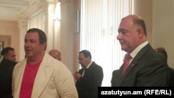 Armenia -- Prosperous Armenia Party leader Gagik Tsarukian (L) and the newly elected deputy parliament speaker Samvel Balasanian, 7Oct 2010.